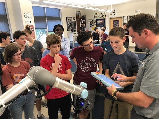Students enjoy a live demonstration of a collaborative robot