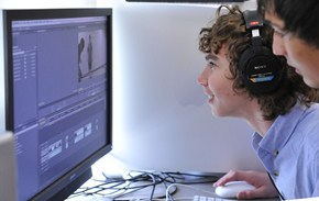 Students work on video editing on one of the district's computers.