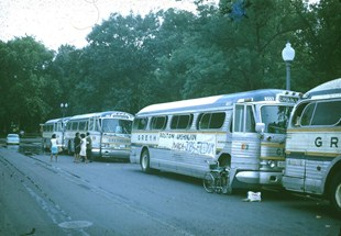 Buses parked along the street during the 1963 March on Washington.