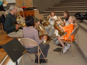 Students learning to play the French Horn.