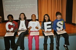 Students at Penn Valley holding letters spelling out CARES.